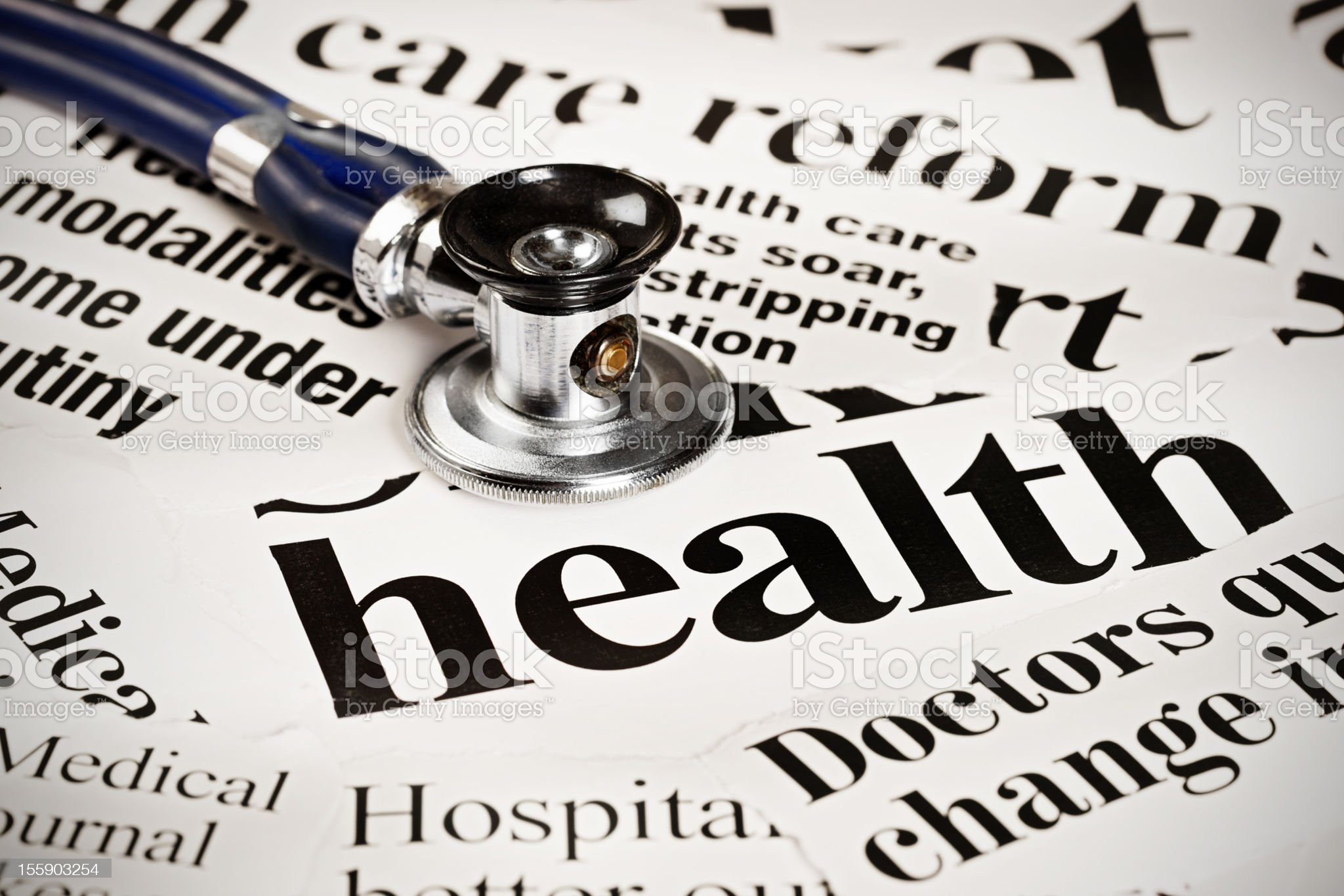 Stethoscope on press headlines regarding medical matters royalty-free stock photo