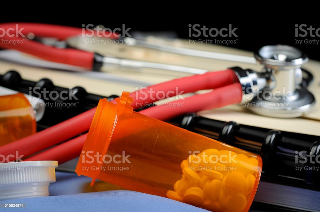 Stethoscope Pills and Folders stock photo