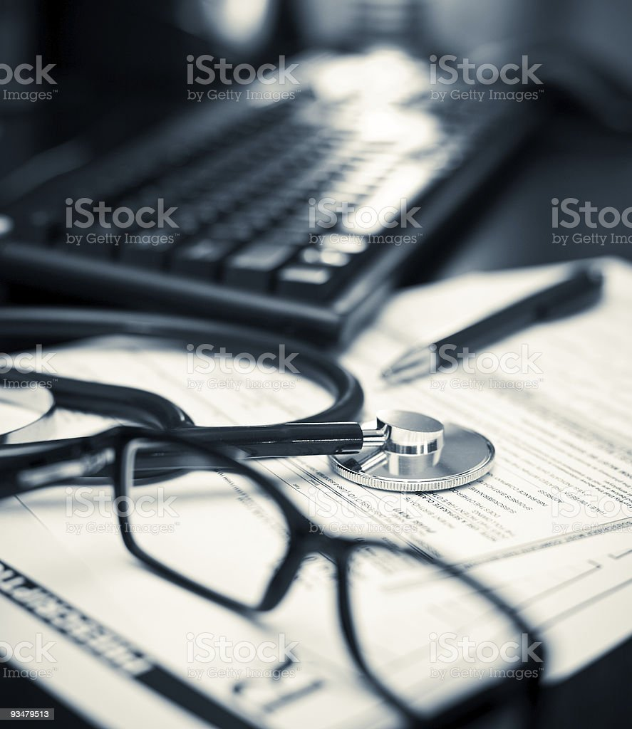 Stethoscope placed next to a prescription pad stock photo
