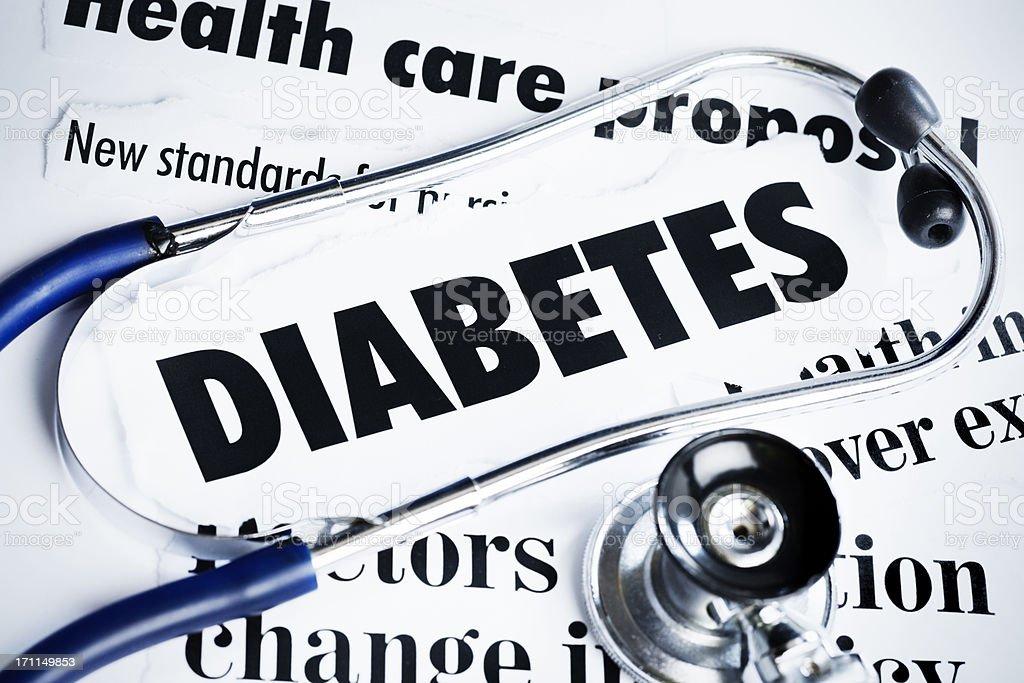 Stethoscope rests on headlines concerning diabetes stock photo