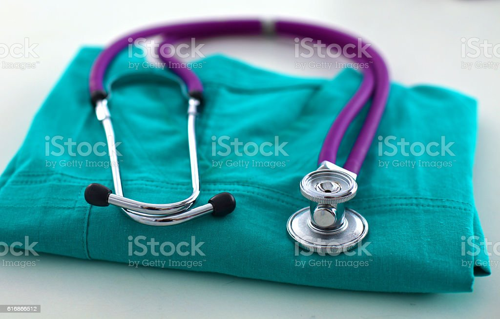 stethoscope shaping  heart and  clipboard on  medical uniform, closeup stock photo