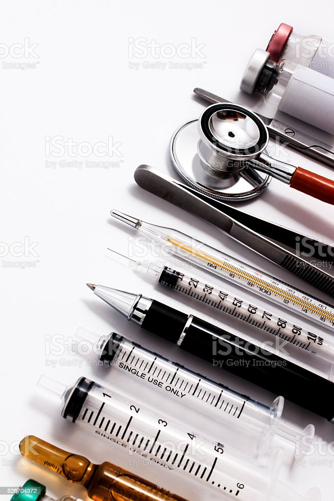 Stethoscope, syringes, scissors, forceps and ampoules. stock photo