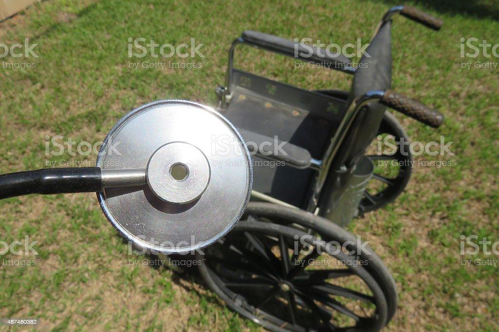 Stethoscope, wheelchair stock photo