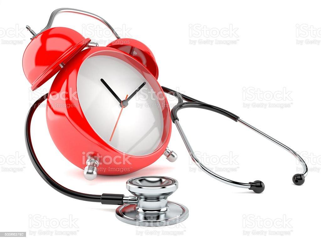 Stethoscope with alarm clock stock photo