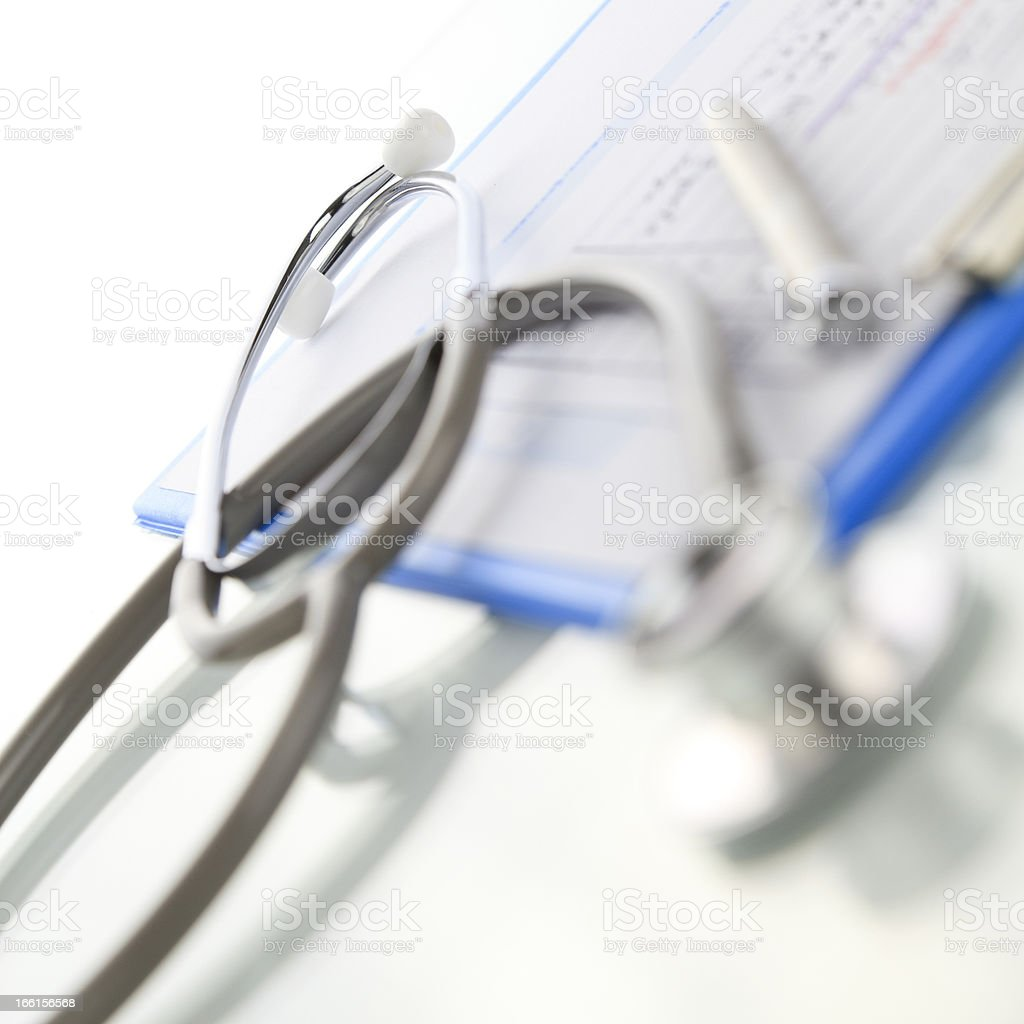 Stethoscope with blue medical clipboard royalty-free stock photo