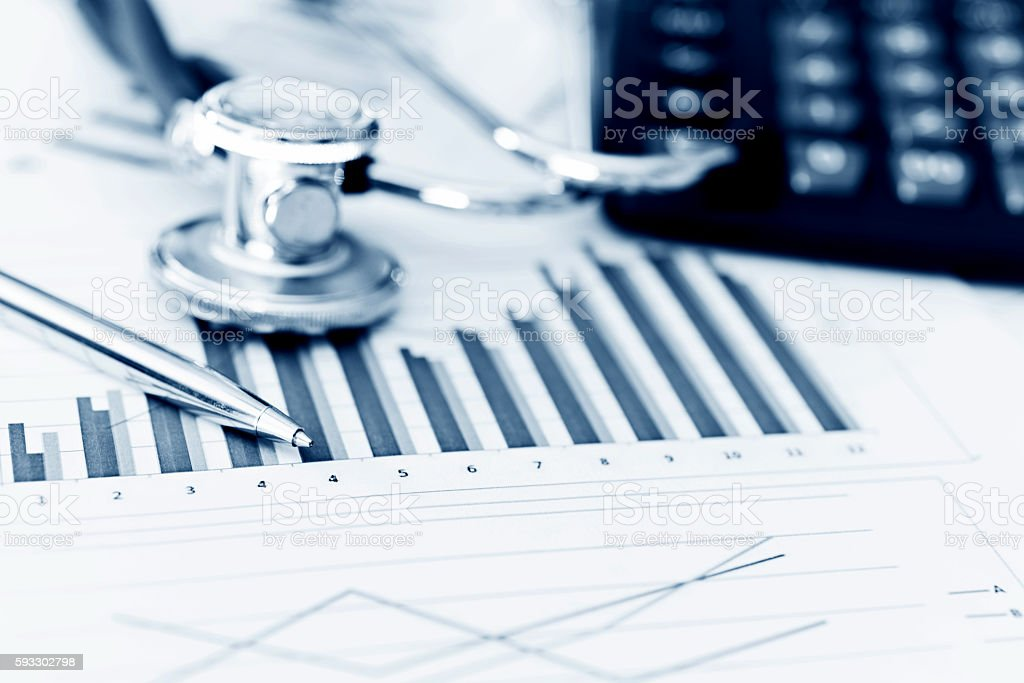 Stethoscope with business graph and calculator stock photo