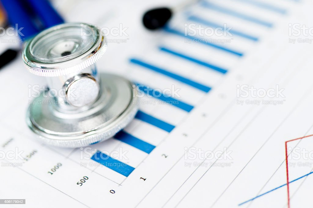 Stethoscope with business graph stock photo