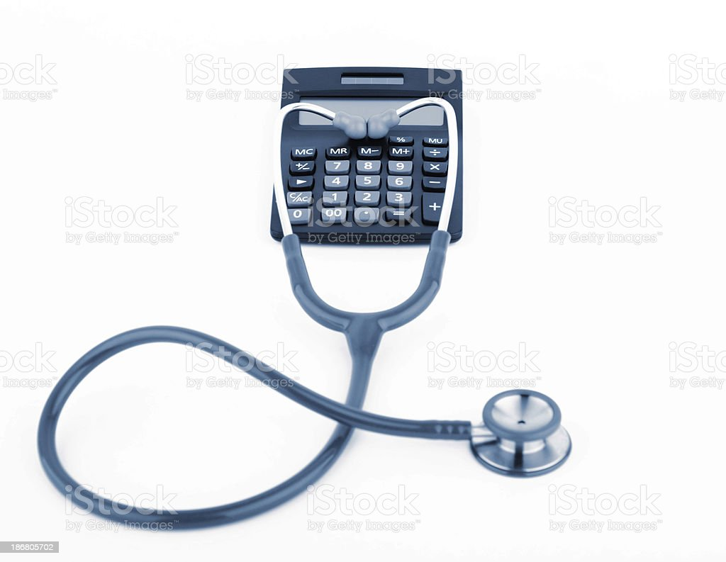 Stethoscope with calculator royalty-free stock photo