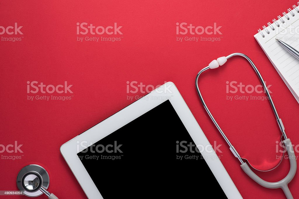 Stethoscope with digital tablet and note on the desktop stock photo
