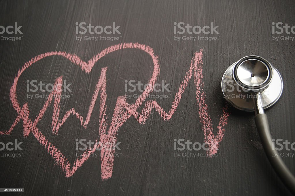 Stethoscope with drawing of heart shape stock photo