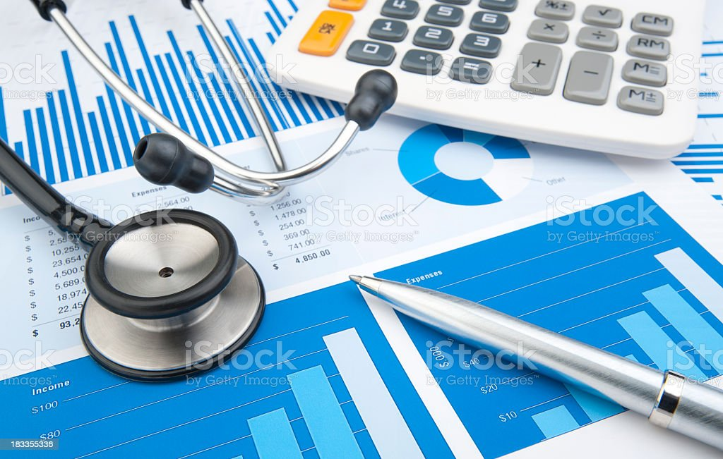 Stethoscope with financial statement, calculator, pen stock photo