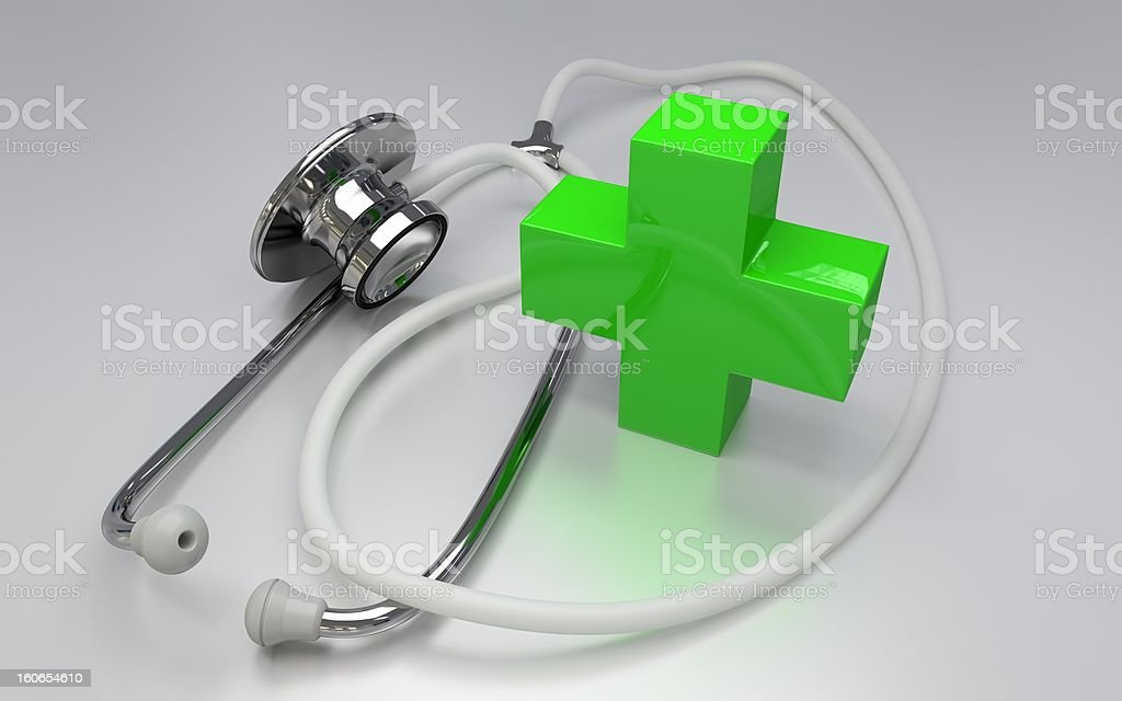 Stethoscope with green cross royalty-free stock photo