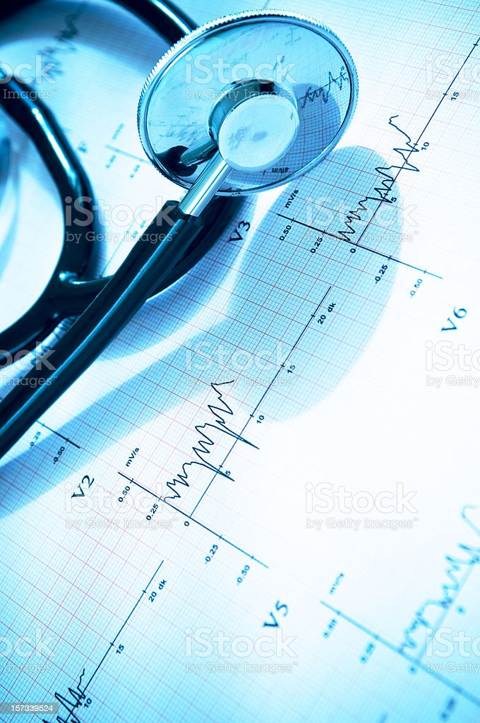 Stethoscope with heart ecg graph royalty-free stock photo