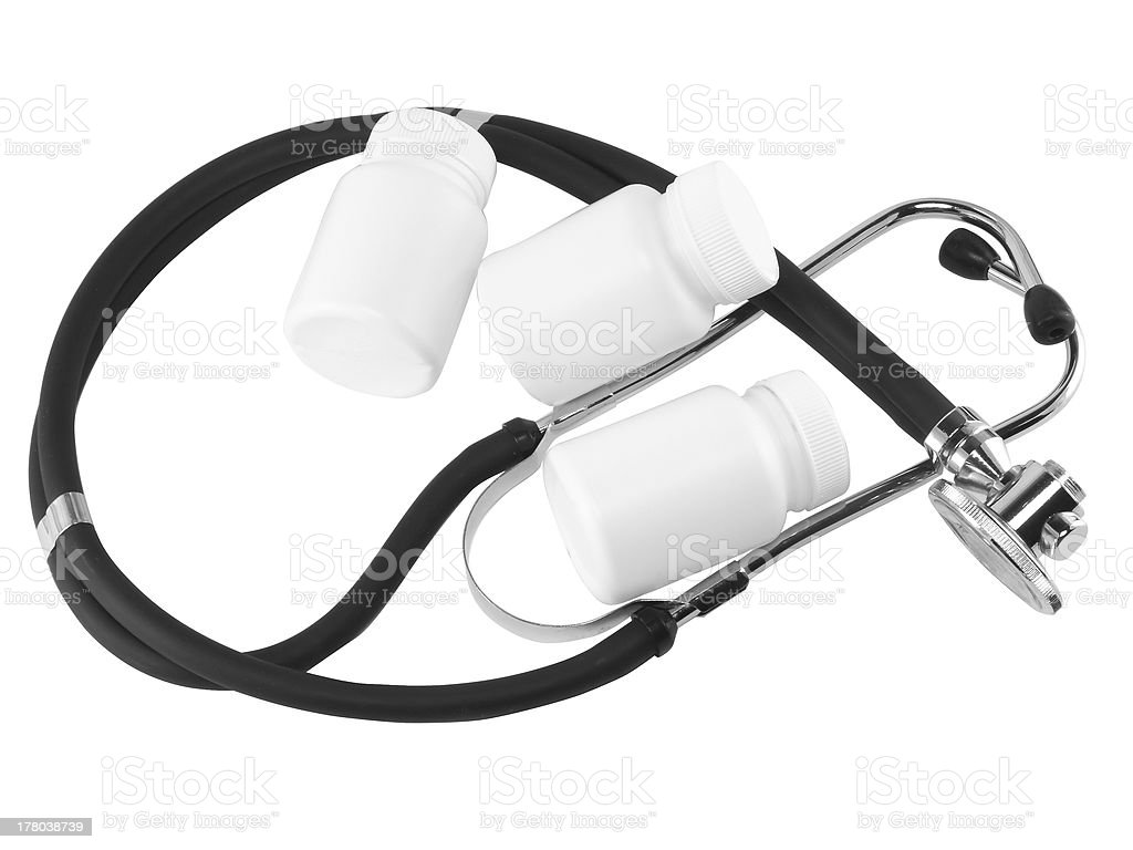 Stethoscope with medicine blank bottles. stock photo