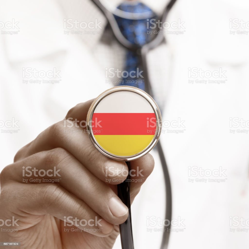 Stethoscope with national flag conceptual series - South Ossetia stock photo
