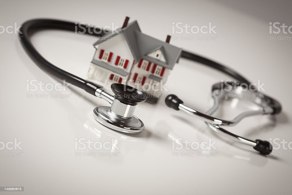 Stethoscope with Small Model Home stock photo