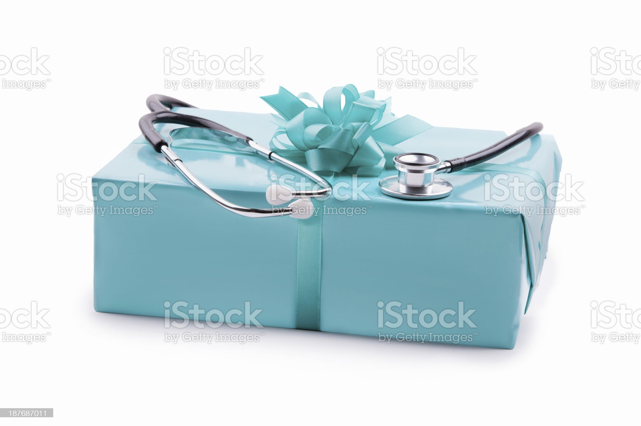 Stethoskop on a turquoise gift box on white royalty-free stock photo