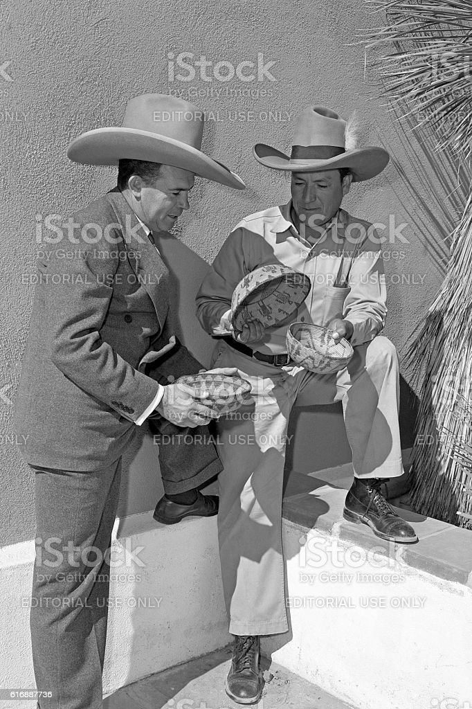 Steven Ochoa and Geronimo Kuth-Li with native American baskets stock photo