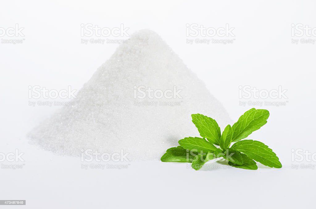 stevia with a pile of sugar stock photo
