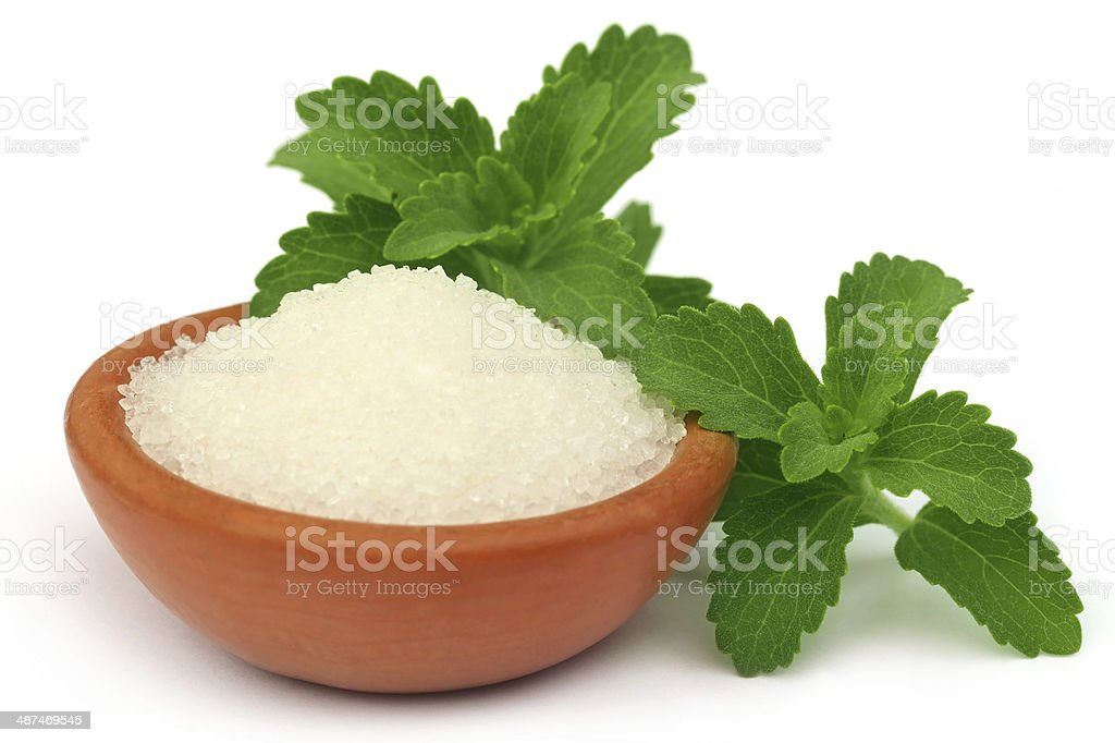Stevia with sugar on a brown bowl stock photo