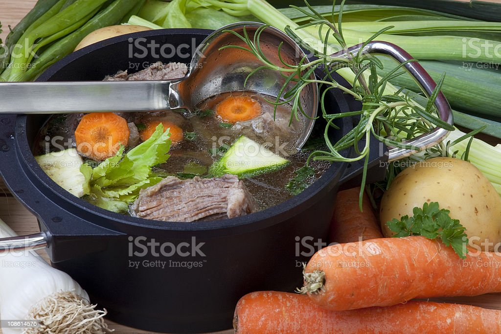 Stew in a pot with beef, broth, carrots and other vegetables royalty-free stock photo