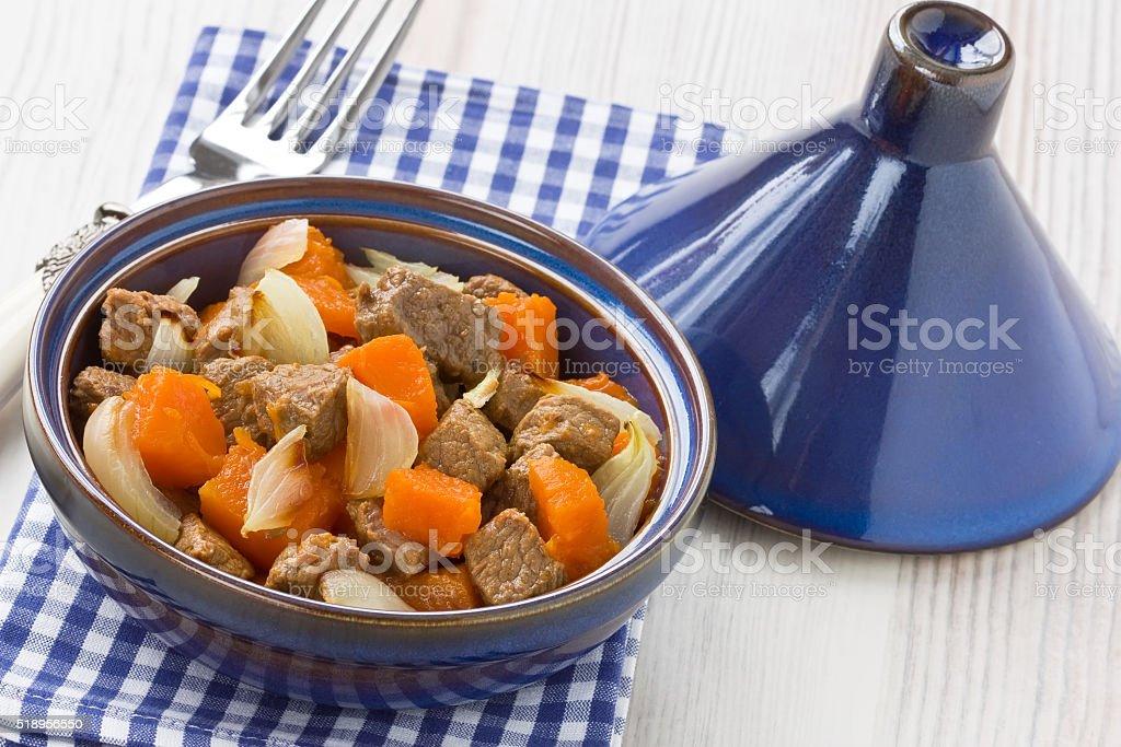 Stew meat with pumpkin in tajine stock photo