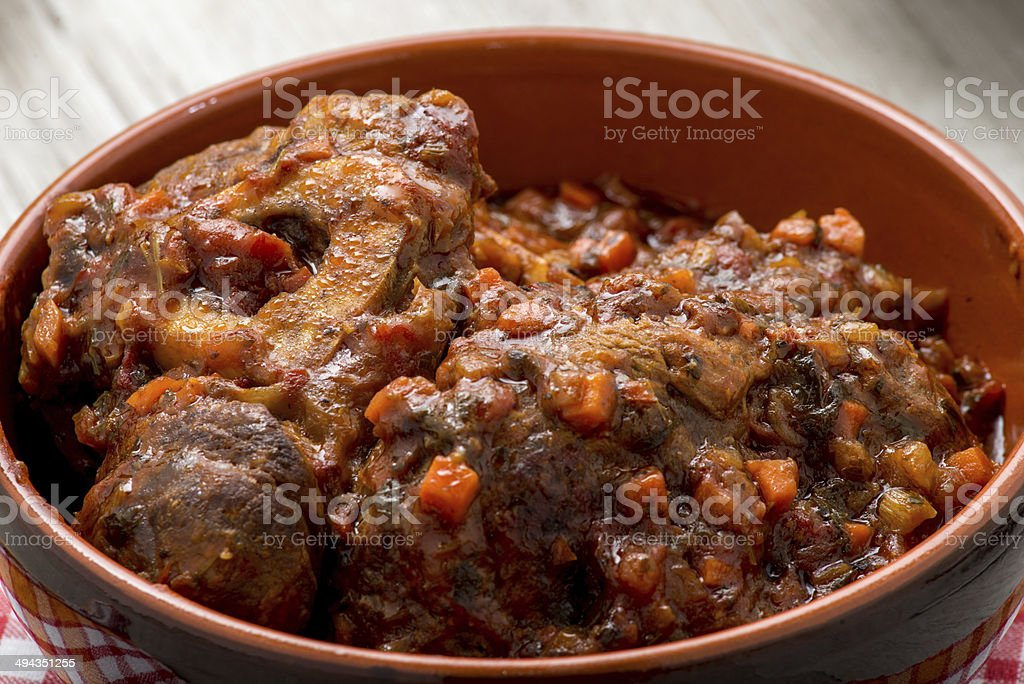 stew with mushrooms in a terracotta bowl stock photo