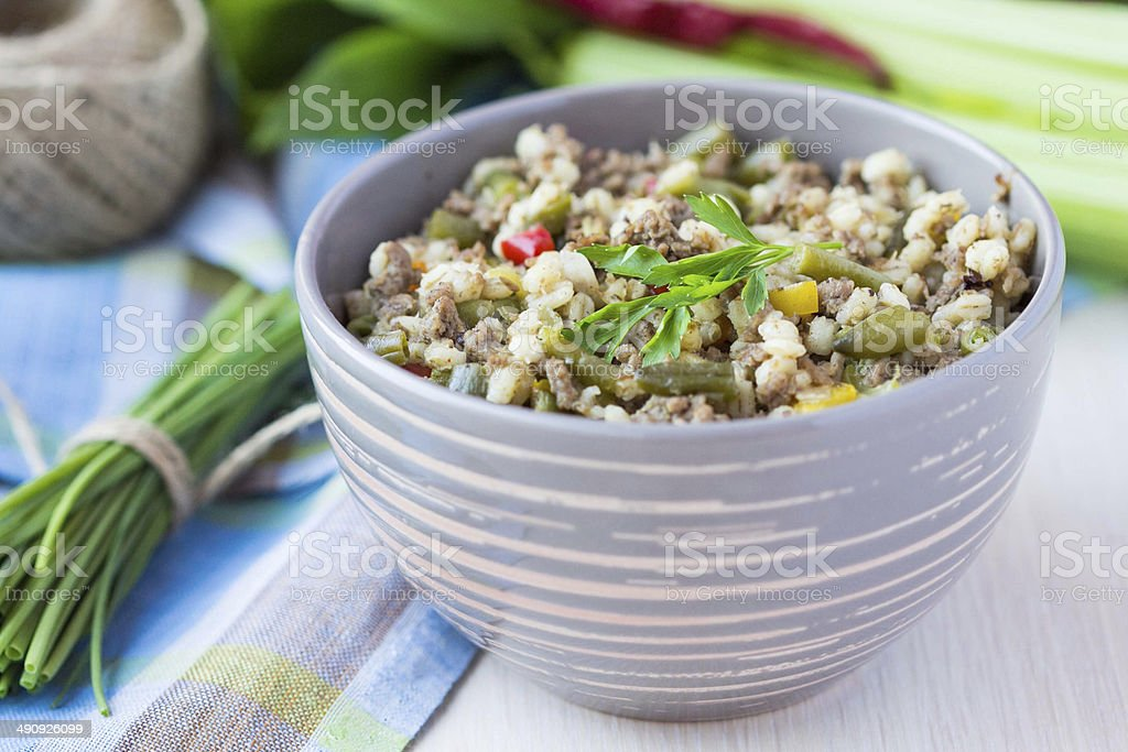 Stew with pearl barley, vegetables, minced meat, herbs stock photo