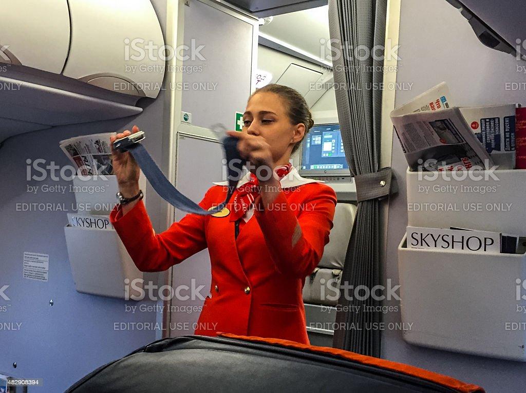 Stewardess giving safety instructions before flight stock photo