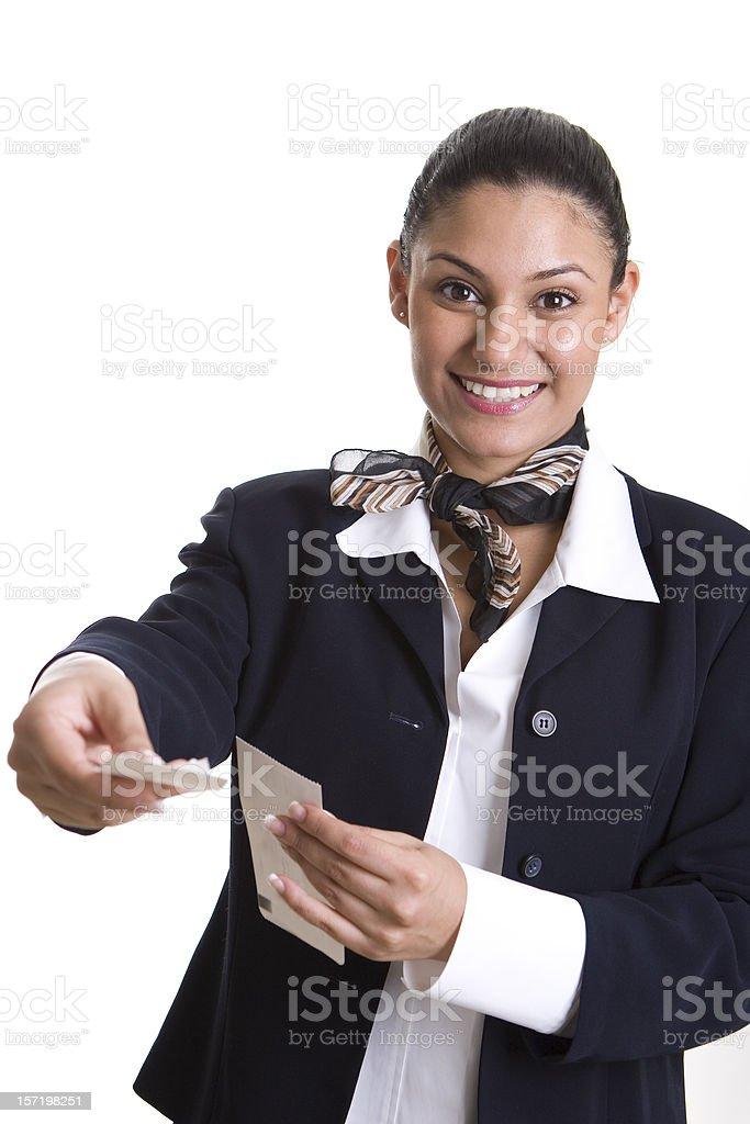 Stewardess handing you your ticket stub royalty-free stock photo