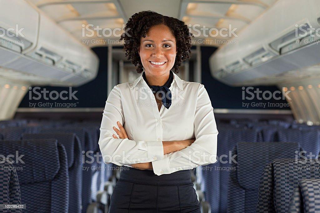 Stewardess on airplane stock photo