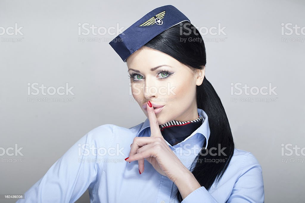 Stewardess quieting down stock photo