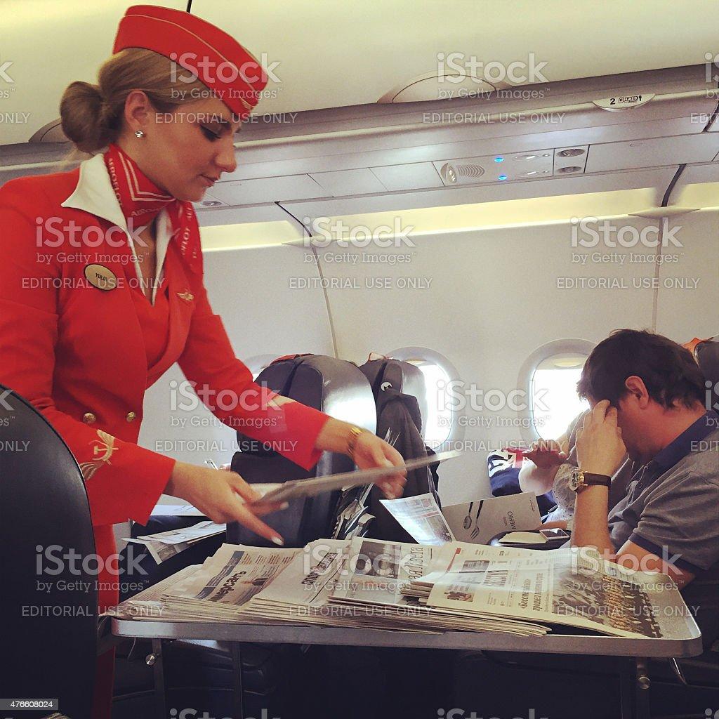 Stewardess serving passengers on board of Aeroflot flight stock photo