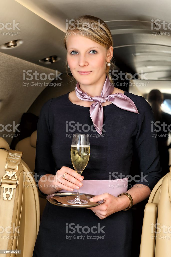 Stewardess with the glass of champagne stock photo