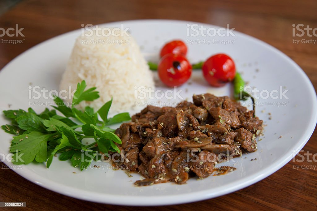 Stewed beef with boiled white rice. - Stock image stock photo
