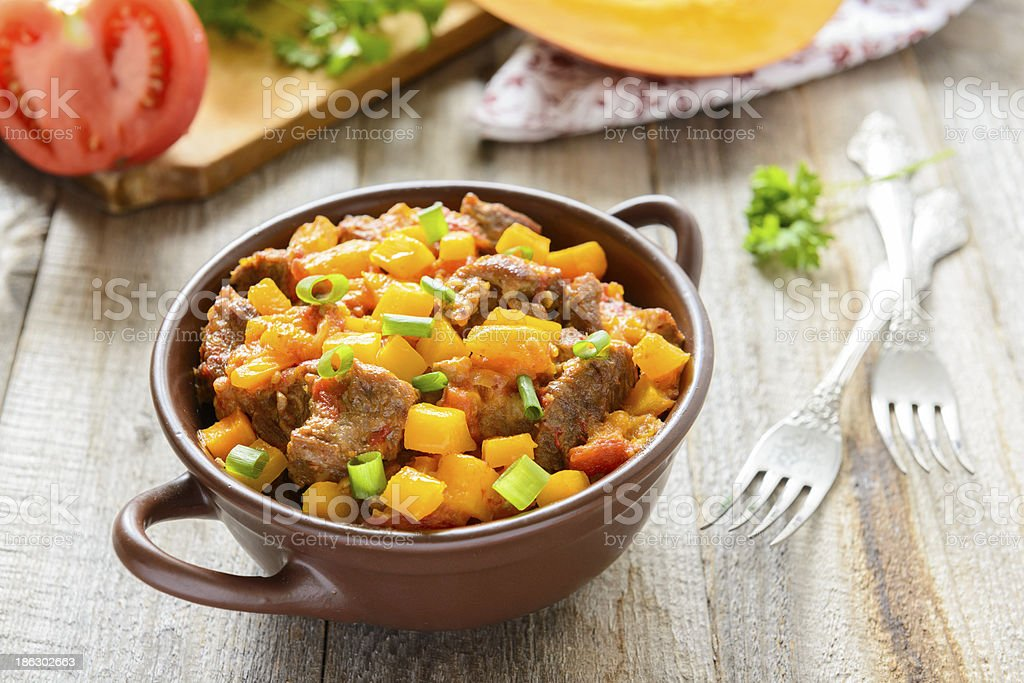 Stewed beef with pumpkin and tomatoes stock photo