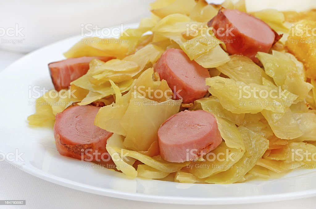 Stewed cabbage with grilled sausages royalty-free stock photo