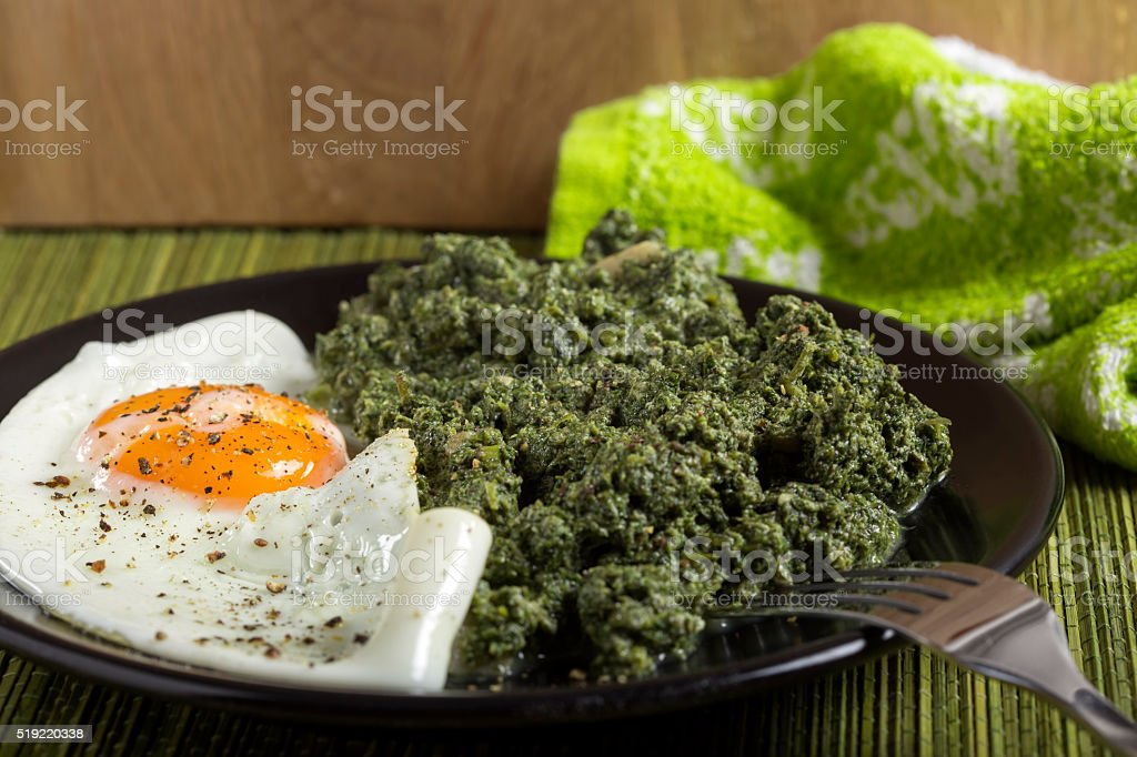 Stewed nettles with egg stock photo