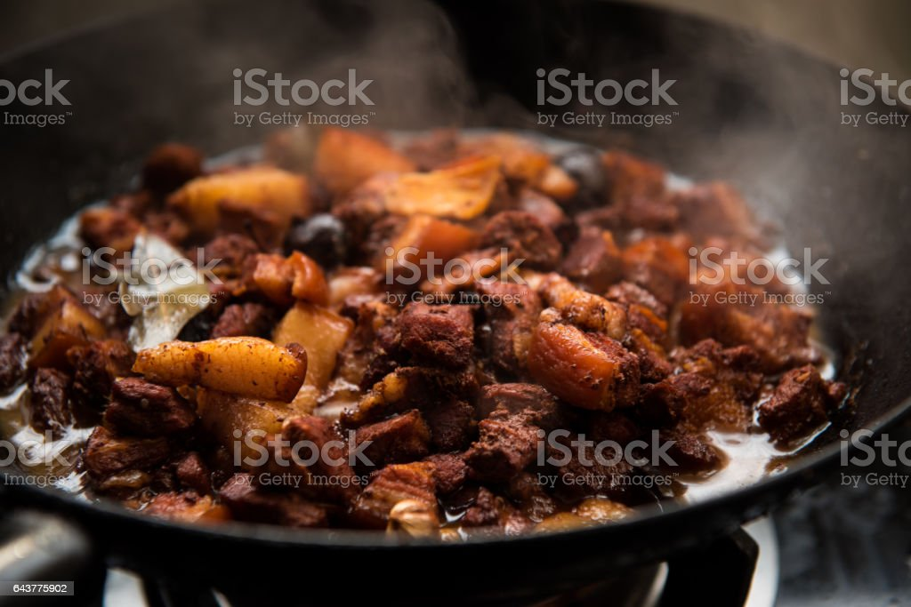 Stewed pork in the pot. stock photo