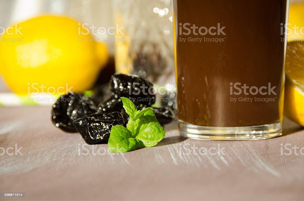 stewed prunes with lemon drinking glass stock photo
