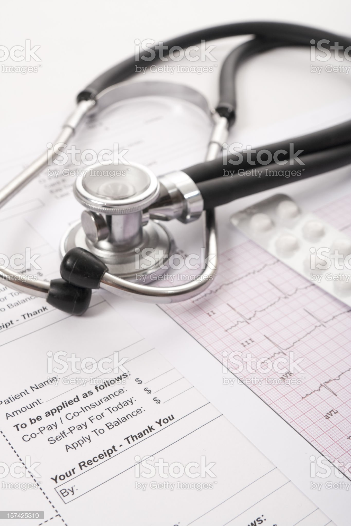 Sthetoscope, EKG, pilss and client receipt royalty-free stock photo