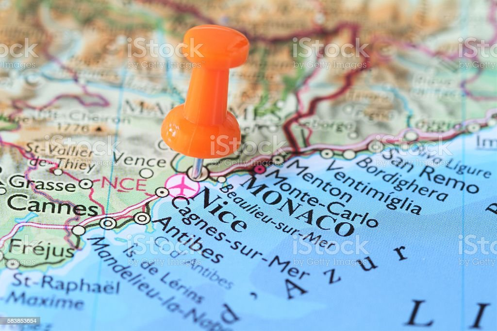Stick pin on map of  Nice France stock photo