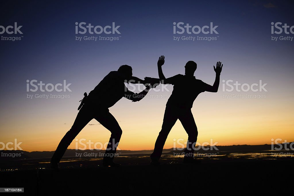 Stick Them Up - Silhouette royalty-free stock photo