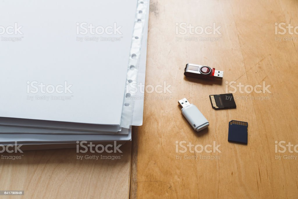 USB stick vs paper vs memory card stock photo
