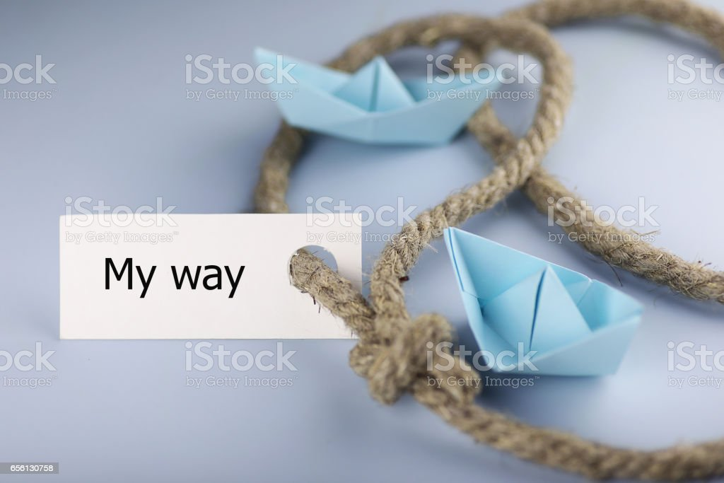 sticker with thick braided rope and ship paper origami stock photo