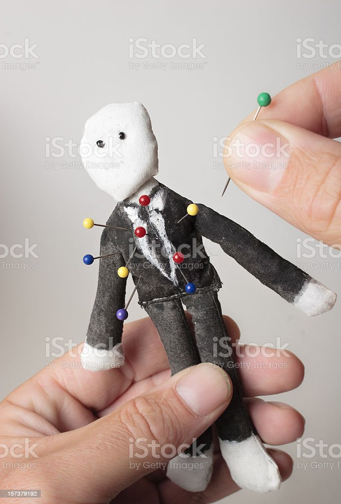 Sticking it to The Man, voodoo doll style stock photo