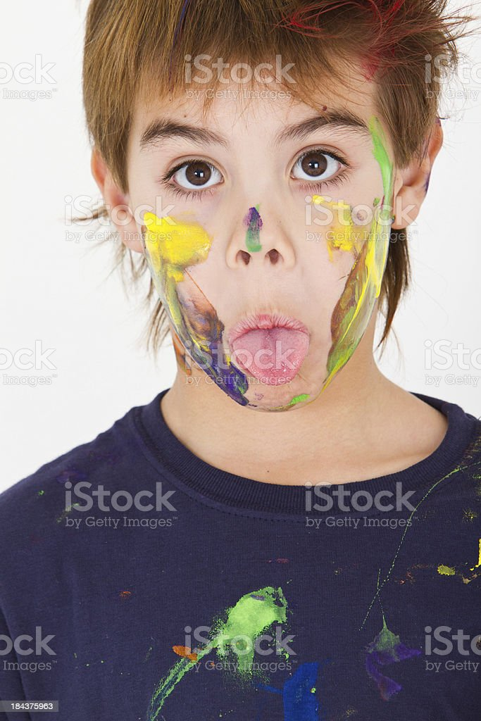 Sticking out tongue young artist royalty-free stock photo