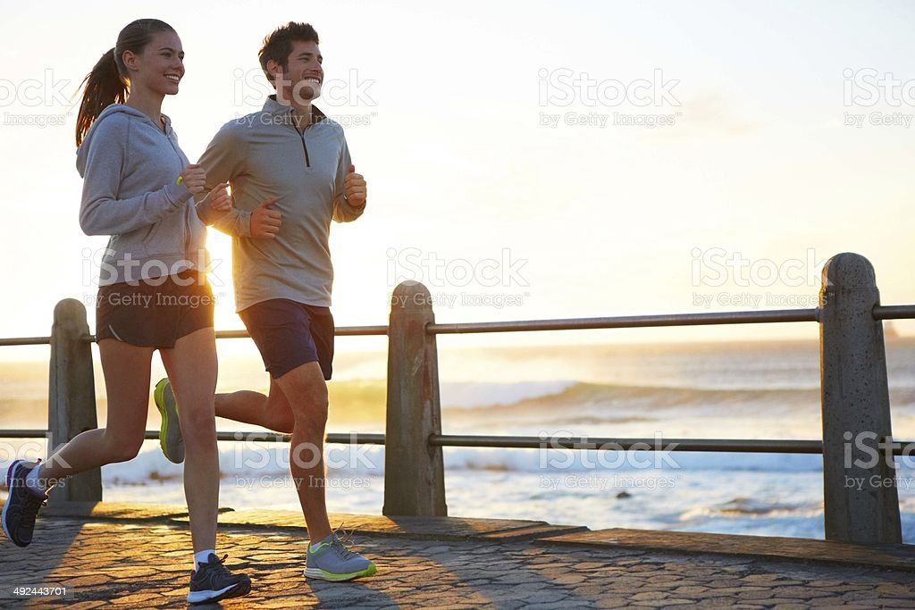 Sticking to their exercise routine while on vacation stock photo