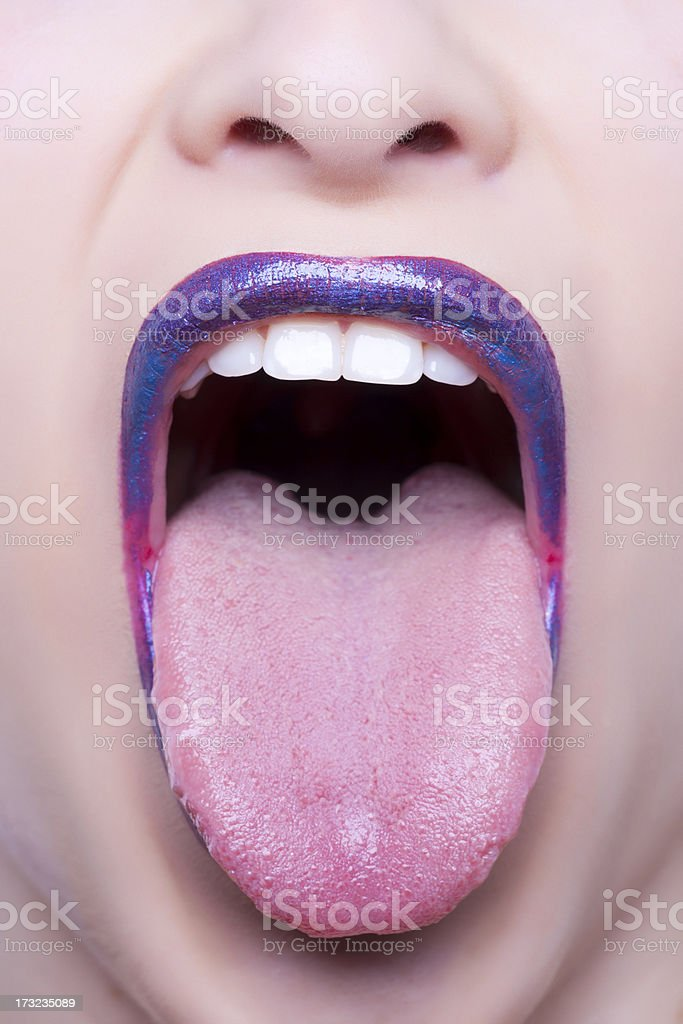 sticking tongue out stock photo