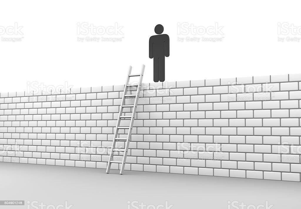 Stickman climbs a wall stock photo